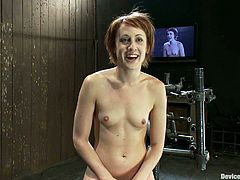 This redhead called Dylan Ryder is hung upside down in a position that leaves her pussy exposed for toying.