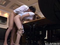 Lovely Japanese chick is having fun with her colleague in an office. They kiss and pet each other ardently and then bang in missionary and other positions.