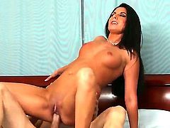 Pretty black haired Nikki Daniels with natural boobies and arousing heavy make up gives head to Michael Stefano and rides on his dick to screaming orgasm in close up.