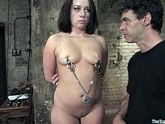 Sweet brunette girl toys her pussy with a vibrator and then gets clothespinned by her master. After that she gives hot blowjob and gets whipped.