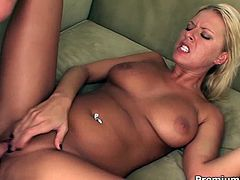Stunning curves of killer beauty Riley Evans look fantastic as she flaunts her big tits and thick ass. She gets her bald cunt fucked doggystyle and takes load on her hooters.
