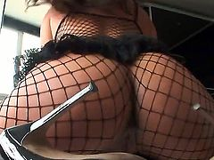 Exotic bombshell Dunia Montenegro with heavy make up and juicy tits in fishnet pantyhose and high heels teases Nacho Vidal with big jaw dropping ass at the photo shoot.