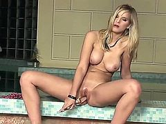 Turned on smoking hot young blonde babe Marry Queen with big tits and firm eatable bums polishes her cunny while teasing and pleasures herself with glass dildo by the pool.