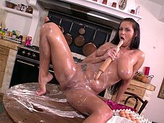 Incredibly voluptuous black haired mommy with gorgeous booty and massive boobs pours milk on her hungry pussy and finger fucks herself with passion.