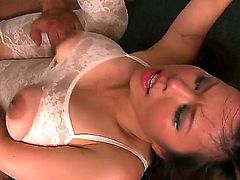 Tempting asian brunette Tigerr Benson with heavy make up in white lace full body stockings and high heels sucks Chucky and Renato and has rough double penetration to loud orgasms.