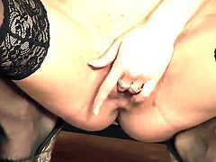 Carina Shay with massive knockers and shaved bush opens her legs on cam with no shame
