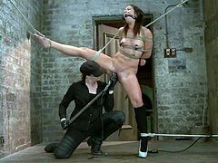 Adorable brunette Mia Gold is having fun in a basement. She lets a mistress bind and hang her up and then gets her cunt unforgettaby toyed.