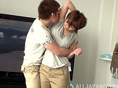 Chubby Japanese milf shows her nice tits to some guy and lets him play with them. Then she lies down on her back, spreads her legs wide and they ahve some ardend sex in missionary position.