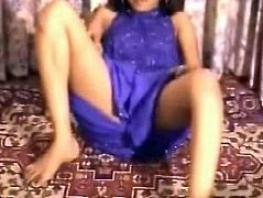 Lustful bitch is wearing sexy purple dress. She poses on cam playing with her body taking teasing positions. The girl is perfect in solo action. Check her out in Indian Sex Lounge porn movie.