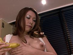 Ruined Japanese hoe sits on the kitchen counter with legs spread aside eating a banana before she starts fingering her aroused vagina in sultry solo sex video by Jav HD.