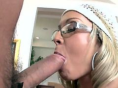 Precious blonde chick with sexy glasses Jessica Moore is naughtily pleasing her boyfriend with hot titjob and getting her asshole licked by him.