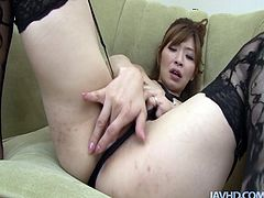 Alluring Japanese babe in sultry black lingerie and lacy stockings lies on her back rubbing shaved vagina with fingers before she switches to doggy style in peppering solo sex video by Jav HD.