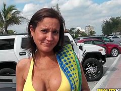 Stunning mature Latina hottie wearing yellow bikini agrees to show off her massive plastic tits for two hundred bucks. Take a look at her bouncy knockers.