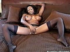 Hot ebony loves to stroke her tight vag with a large toy in amazing solo action