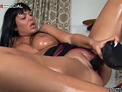 Angelika Black is a super hot brunette babe with an amazing body. She gets naked, and fucks her own slippery pussy with a huge black rubber cock!