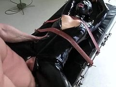 Stunning Sarah Jane Ceylon gets whipped by TJ Cummings. After that she blows a cock and gets her pussy fucked through her hole in the bodysuit.