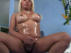 Annalise is a dangerously hot fair-haired shemale with oiled up big tits and stiff dick. She shows off her sexy body as she beats her meat with legs apart in front of the camera.