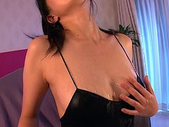 Fuckable Japanese milf sits in front of cam in black one-piece lingerie rubbing her steamy body with hands before she gets to juicy ass in peppering solo sex video by Jav HD.