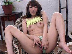 Playful Japanese milf sits in the armchair with legs spread aside wearing sheer green lingerie while rubbing her aroused cunt with fingers before she gets to her small perky tits in peppering solo sex video by Jav HD.