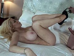 Blonde MILF is wearing tiny black dress hugging her body tight. She seduces handsome young stud for sex. So he thrusts his dick in her dirty mouth pushing the tool in the throat. Later, she gets her snatch polished properly.
