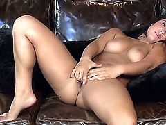 Black haired young beauty Eva Lovia with natural boobs and juicy body figure get naked and stretches her pink honey pot to warm orgasmic feeling on leather couch.