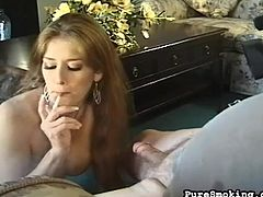 Blonde babe gives amazing blowjob while smoking and blowing the smoke all over