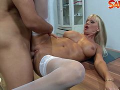 This hot blonde MILF shows off her amazing body and starts deepthroating his massive cock before taking it in her tight butthole!
