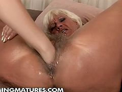 See a vicious blonde mature getting her hairy clam dildoed with a baseball bat by a sexy young brunette. Then she puts her hand into action and fists that mature cooch into kingdom come.