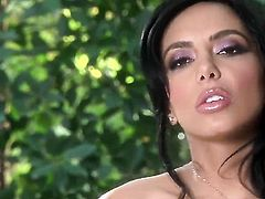 Lela Star with giant boobs and shaved twat touches her melons in a playful manner