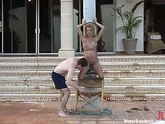 Submissive blonde Jenni Lee gets tied up and tortured outdoors. Then she gets into a pool and lets some dude drown her.