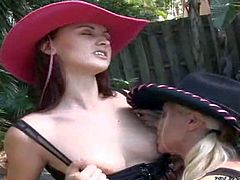 Stunning blonde Molly Cavalli and her redhead babe Karlie Montana enjoy in playing dirty cowgirls in the back yard, wearing their hotpants and boots along with cowboy hats and make out