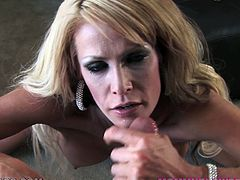 Slutty blonde MILF takes her lingerie off and fingers her vagina. After that she comes up to a guy and blows his dick. She also gets her mouth filled with cum.
