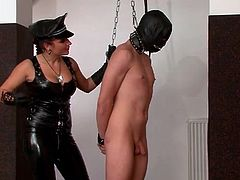 Kinky leather mistress flogs his naked body