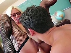Seductive and tempting blonde milf Nikita Von James with big fake balloons and provocative glasses in fishnet lingerie and stripper shoes gets licked by Giovanni Francesco and rides on his cock.