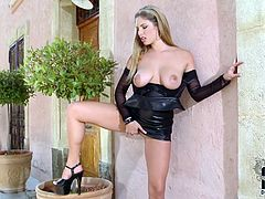 She is fantastically seductive blond babe having killer body. She wears sexy leather dress that emphasizes the beauty of her body. She flashes her boobs and pussy. Damn, this blodie blows my mind.