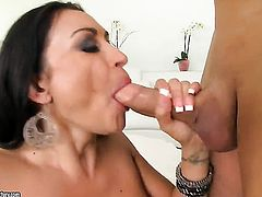 Mature hoochie Claudia Valentine with juicy breasts gives unforgettable blowjob hard cocked guy