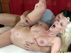 Curvaceous blonde take her bikini off and gives blowjob & titjob combo. After that she gets her shaved pussy drilled deep and hard.