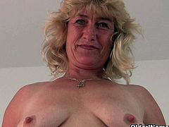 This horny and sexy blonde grandma takes off her dress and spreads her old pussy wide, She wants you to suck it,She treats her pussy well by rubbing and fingering it.Enjoy!