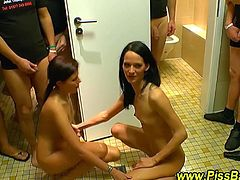 These two brunettes drink piss and take numerous golden showers. They are soaked in piss by all the guys.