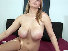 She is so hot and can't wait to show off her huge knockers. You will be so hypnotized by the beauty of those huge boobies.