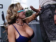 Nikki Sexx goes down on her man in the office and tugs away at his big penis. He fucks her between her juicy, big tits and jacks him off, until his cum goes flying all over the place, including her beautiful breasts.