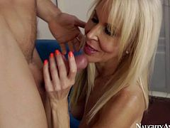 Erica Lauren is a sinfully sexy busty blonde milf with hard body. She takes off her black panties in front of her sons friend and gets her hairy pussy fucked deep on the bed.