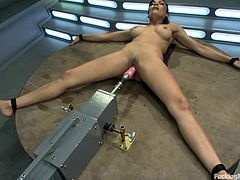 Slutty brunette Beretta James gets a chance to test a fucking machine and she doesn't lose it. She lifts her leg high up and gets her twat pounded remarcably well.