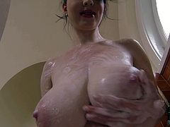 Turned on nude brunette Karina Heart with gigantic jaw dropping natural knockers and soft milky skin enjoys teasing under warm shower in awesome breast play filmed in point of view