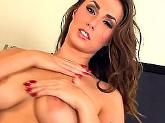 Paige Turnah has fire in her eyes as she toys her bush