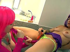 Cute teen babe Beladonna and her lesbian playmate make out before fucking with huge toys