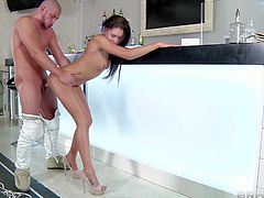 Timo Hardy gets his hands on his new neighbor brunette babe and slamms her shaved slit in doggy pose in his kitchen in the hot afternoon session and enjoys