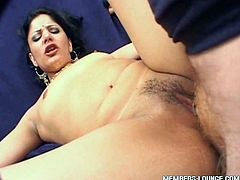 She opens her legs wide and pleases that white guy. He is having awesome time fucking her missionary style on the couch.