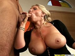 Naughty blonde girl exposes her huge boobs and gives a blowjob. After that she lies down on a sofa and gets fucked rough. She also gets jizzed on her tits.