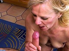 Lili is a mature babe, a hot mature blonde in red dress and she enjoys this young cock very much. She slurps it up and then bends over to take it up her mature hairy cunt.
